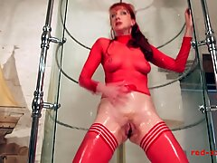 cougar red thrusts a dildo in her pussy while taking a shower