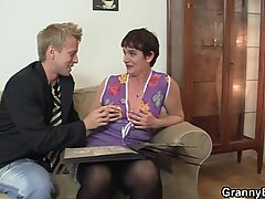 Old granny in black stockings rides his meat