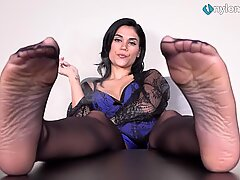 Hot brunette smockes a cig with her nylon feet in your face