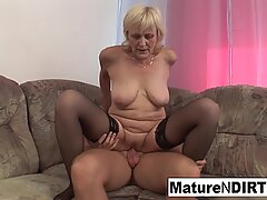 Old grandma takes a hard pussy pounding on the couch!